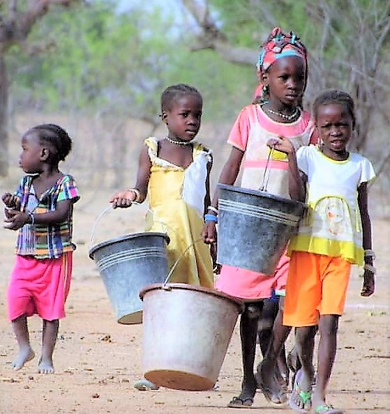Chicldren carrying water
